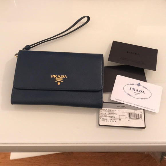f2b732205255 Authentic Prada Saffiano Leather Wristlet. M_5afd05ea36b9de8cce4be538